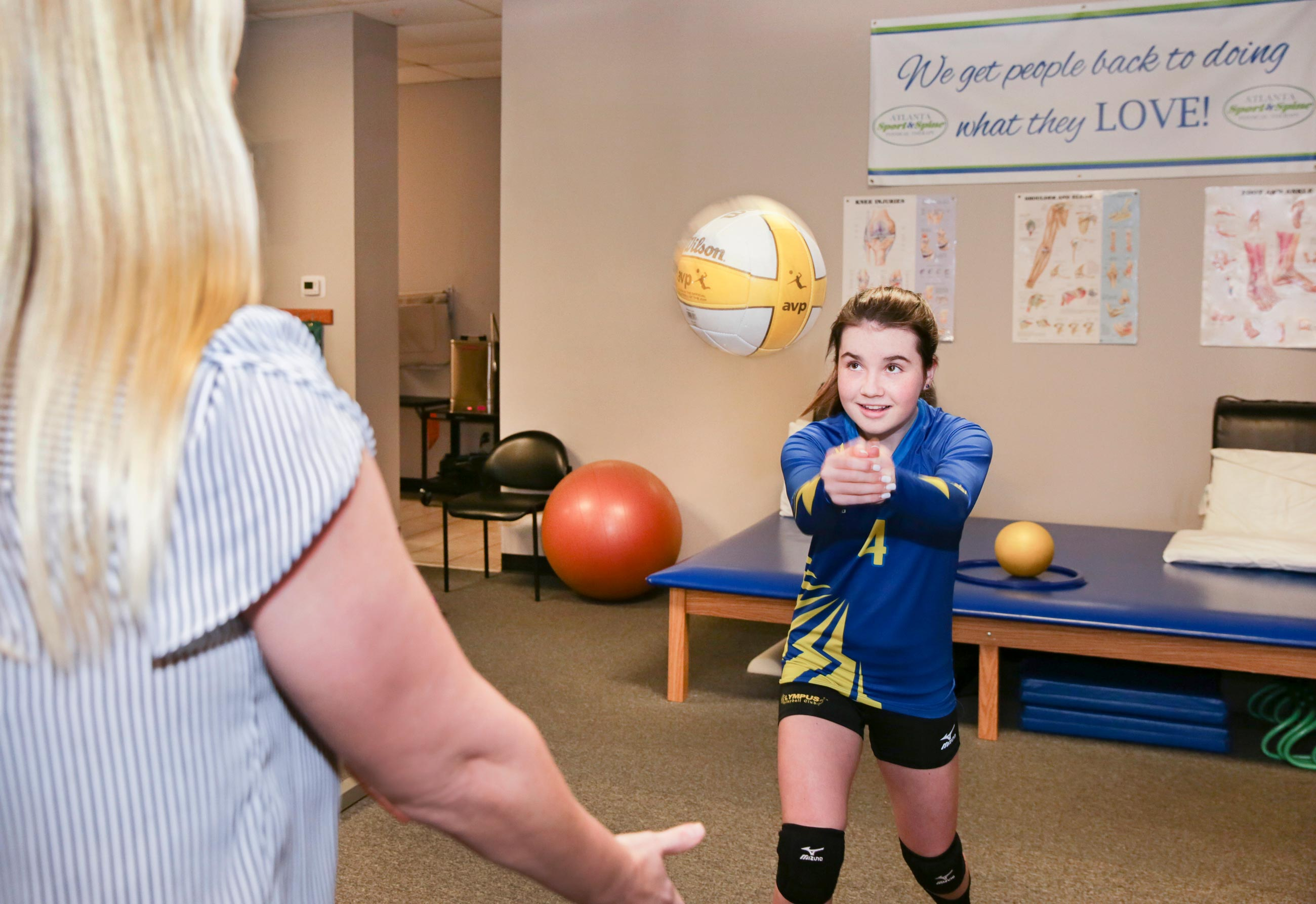Lindsey Knowles helps with volleyball as part of the the Sports Medicine service at Atlanta Sport and Spine