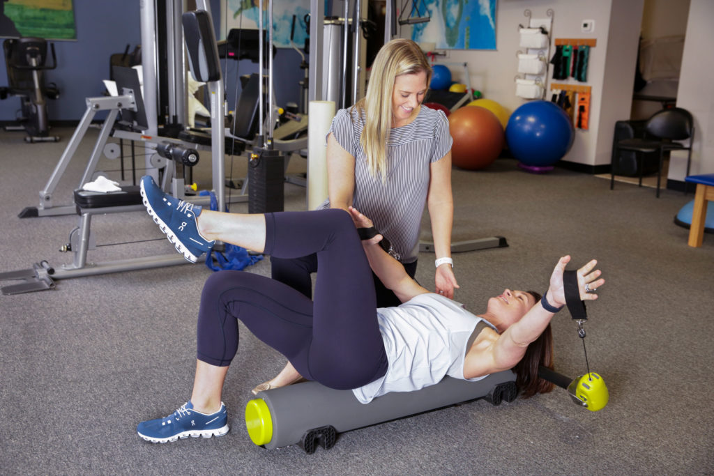 Atlanta-Sport-and-Spine-Physical-Therapy-fitness-pilates-arm-extension-1